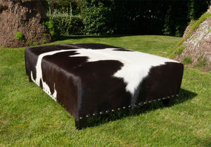Cowhide Ottoman New Zealand with Wood Legs & Studs 120x90x40cm
