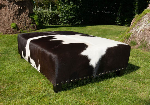 Image of Cowhide Ottoman with Wood Legs & Studs 120x90x40cm