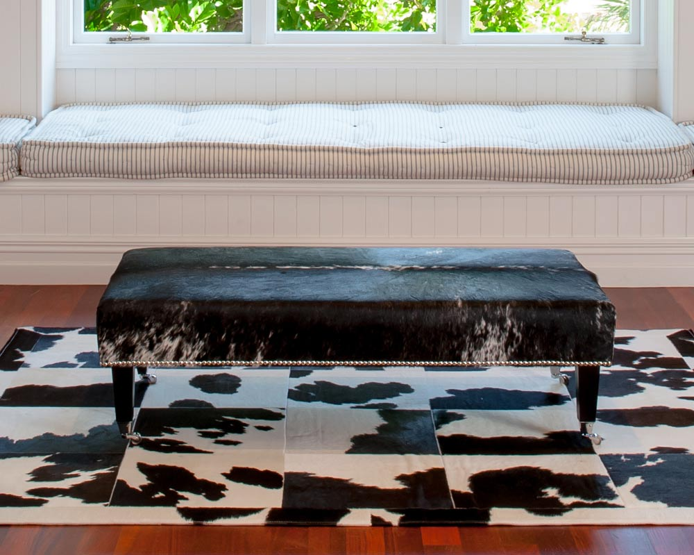 Cowhide Ottoman with Wood Legs 130x70x38cm Studs & Caster wheels