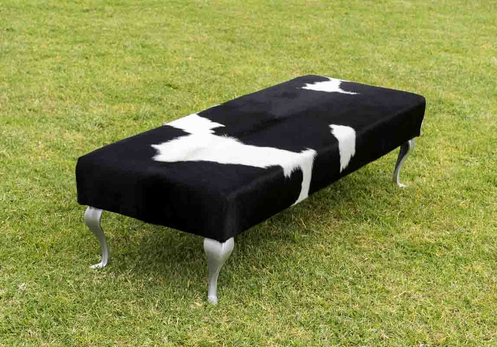 Large black & white cowhide bench seat ottoman with metal legs