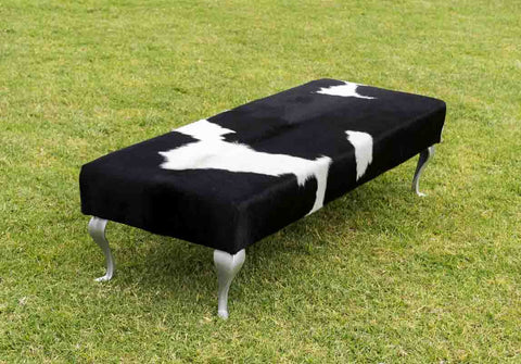 Image of Large black & white cowhide bench seat ottoman with metal legs