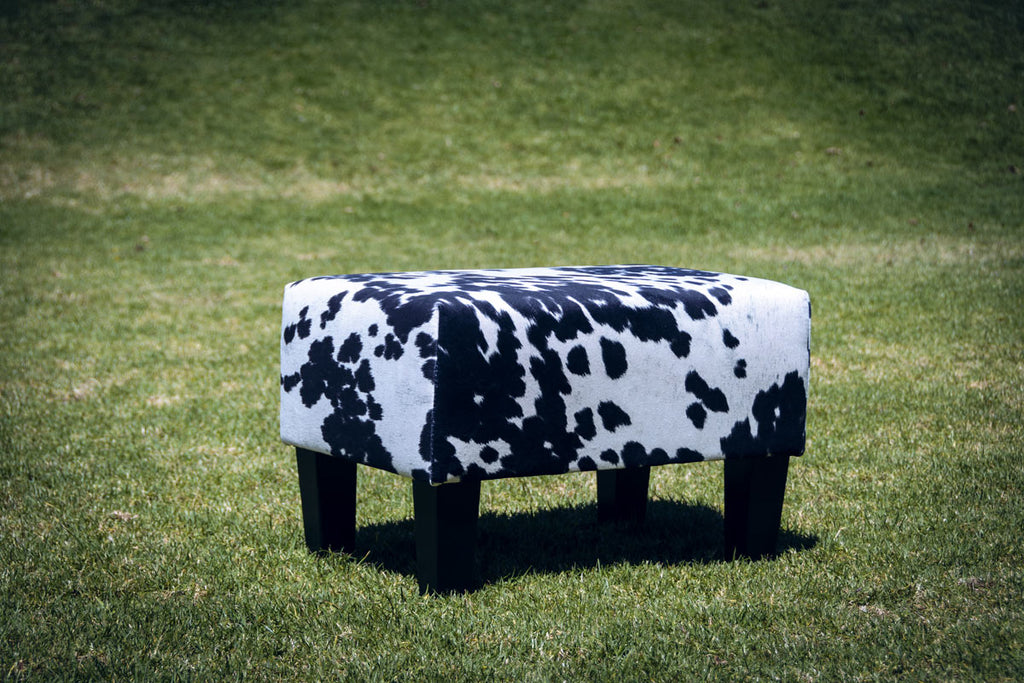 Faux Cowhide Footstool with Wood Legs 55x40x37cm