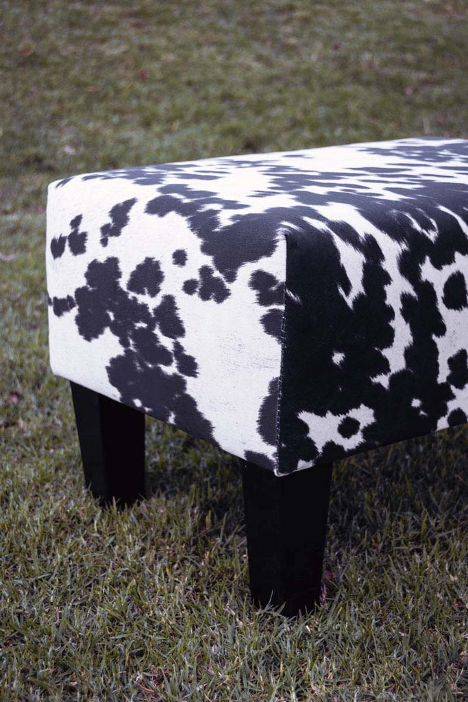 Spotty fake black & white cow skin fabric footstool
