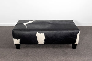 Cowhide Ottoman with Wood Legs 120x75x38cm