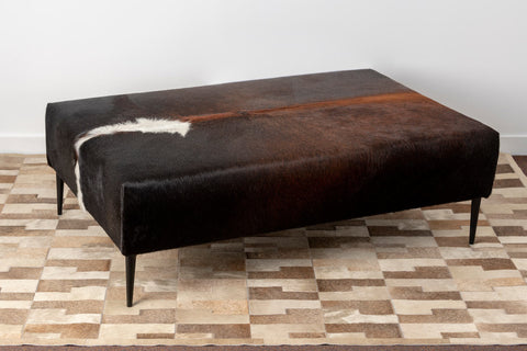 Image of Rich dark brown cowhide ottoman