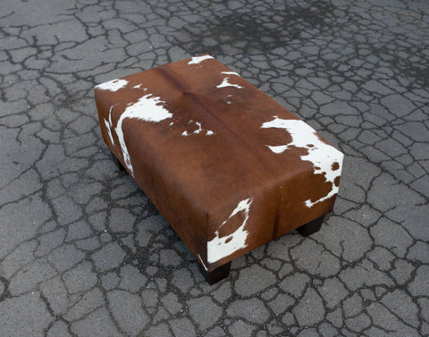 Image of Cowhide Ottoman with Low Wood Legs 80x50x35cm