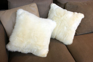 Cream possum fur cushions