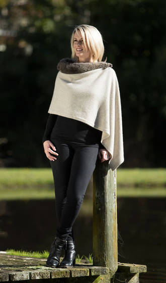 ONE SIZE fits most women wrap cape. A luxury blend of 20% possum fur mixed with 70% merino lambs wool and 10% silk.