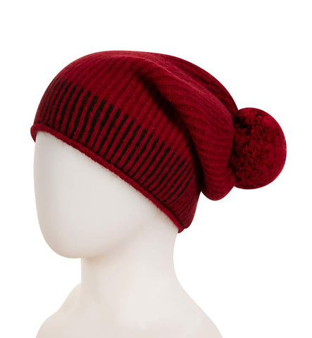 A comfortable unisex slouch beanie with a pom pom