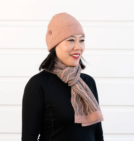 Pearl pink flip possum wool beanie with button detail