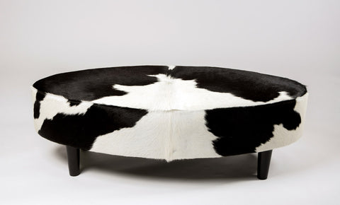 Image of Black & White Cowhide Ottoman Oval Wood Legs 120x60x38cm