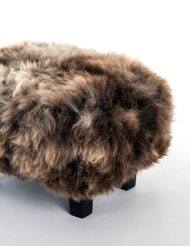 Image of A cute chocolate wool sheepskin footstool