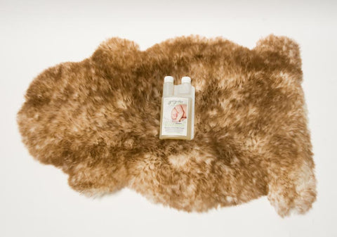 Large Sheepskin Pet Bed and Cleaning Products