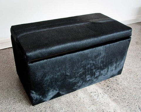 Image of Black cowhide storage ottoman furniture