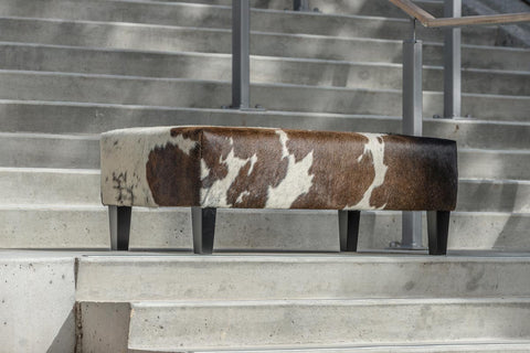Image of Cowhide Ottoman with Wood Legs 110x60x40cm Gorgeous Creatures