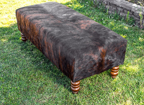 Cowhide Ottoman with Turned Wood Legs 138x60x50cm