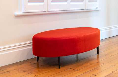 Image of Orange velvet oval ottoman furniture