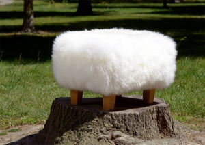 White Sheepskin Footstool with Light Wood Legs
