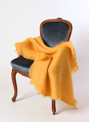 Yellow ochre mohair chair throw