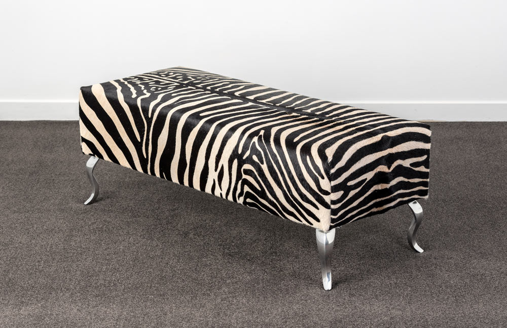 Zebra cowhide ottoman with metal legs Gorgeous Creatures