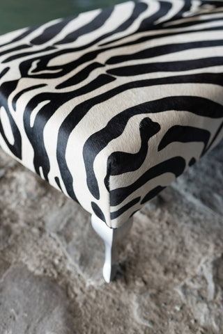 End of bed or bench zebra print cowhide ottoman