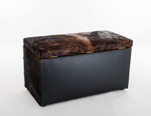 Storage ottoman in cowhide by Gorgeous Creatures