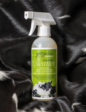 Gorgeous Creatures cowhide cleaner spray to clean a cowhide rug