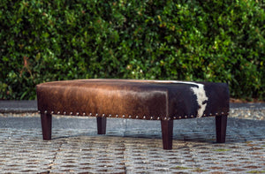 Cowhide Ottoman NZ Wood Legs & Antique Copper Studs 120x60x35cm