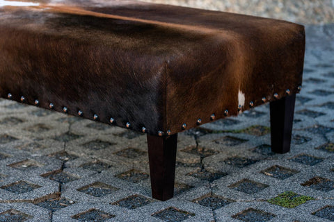 Image of Cowhide Ottoman with Wood Legs & Antique Copper Studs 120x60x35cm