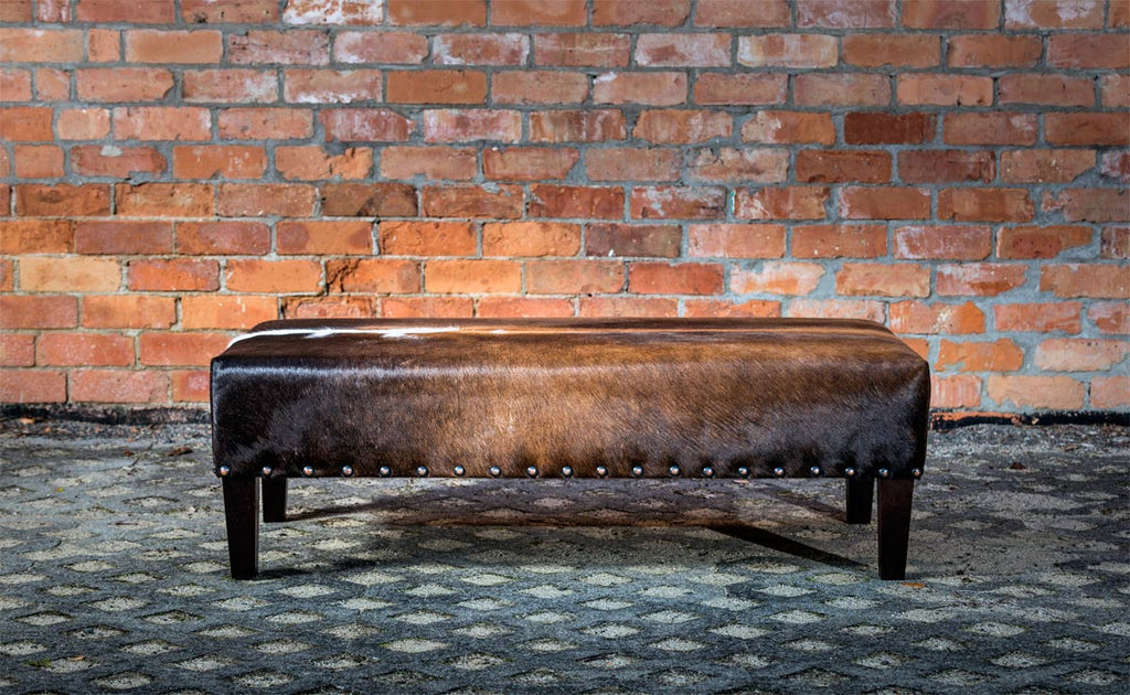 Cowhide Ottoman with Wood Legs & Antique Copper Studs 120x60x35cm
