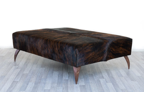 Image of Cowhide Dark Exotic Ottoman with Curved Copper Legs 120x90x38cm