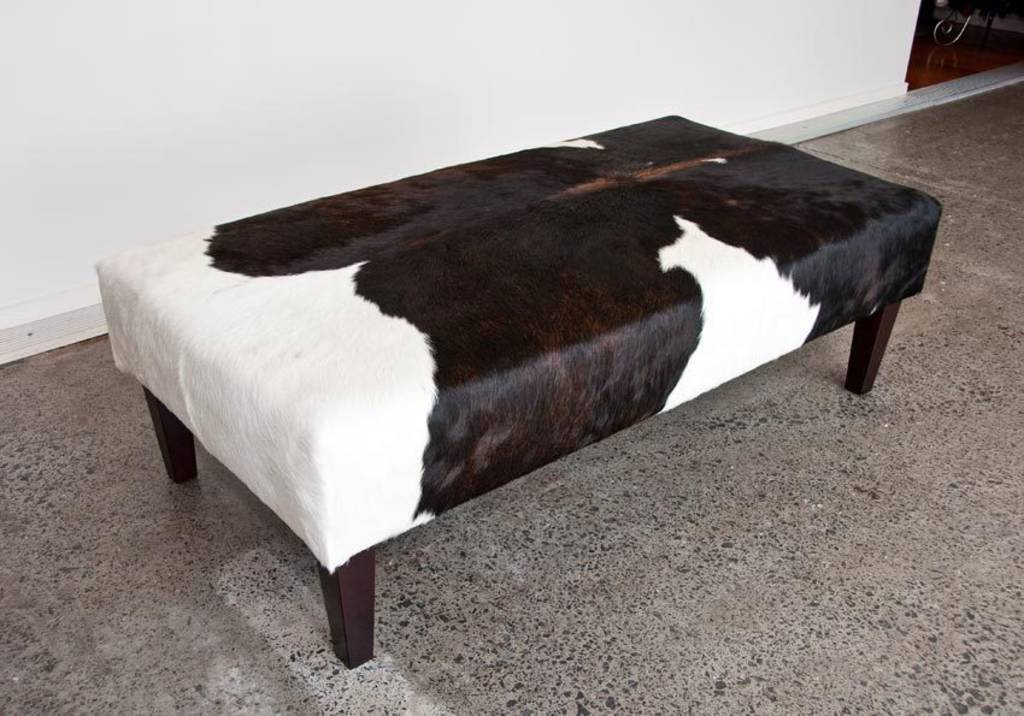 Cowhide Ottoman with Wood Legs 130x65x40cm