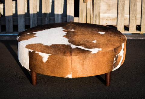 Image of Cowhide Ottoman Round Brown and White Wood Legs 110x110x40cm