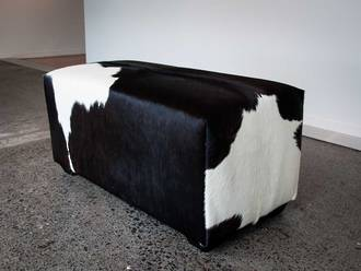 Chocolate and white cow skin ottoman small deep rectangle