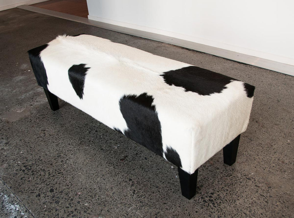 Black & white cowhide bench seat ottoman
