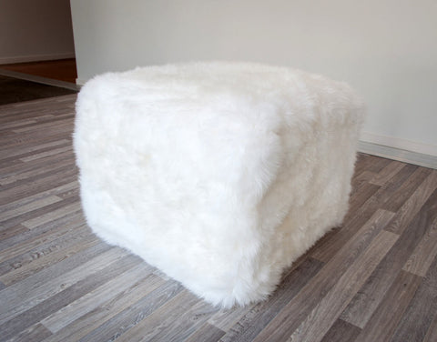 A cute white wool sheepskin footstool