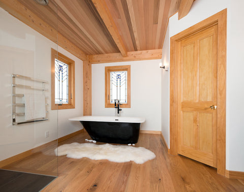 Ivory Wool Sheepskin Rug in a bathroom