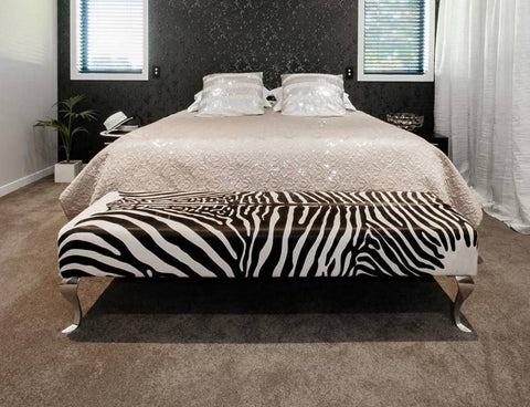 End of bed zebra print cowhide ottoman