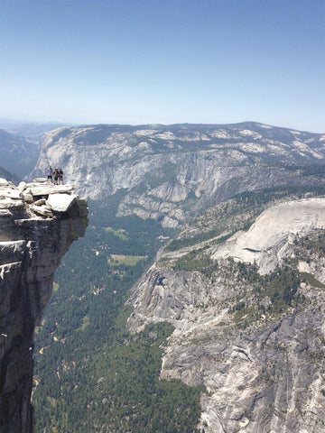 Jonathan Caldwell's three sons – Arran, Francis and Lucian standing proudly at the top of Half Dome Mountain in Yosemitie California