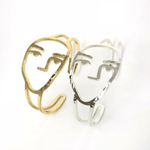 Poker face art bangles in gold and silver