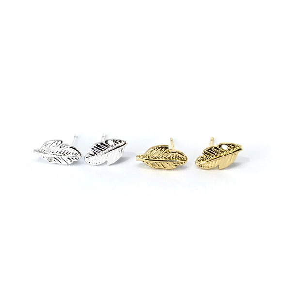 Tiny leaf feather stud earrings in gold / silver