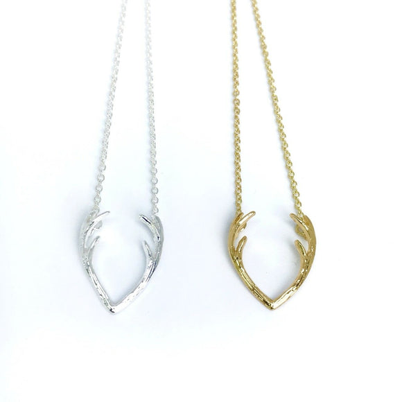 Dainty deer antler necklaces in gold and silver