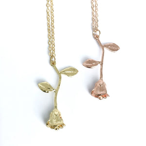 Elegant rose charm necklaces in gold and rose gold