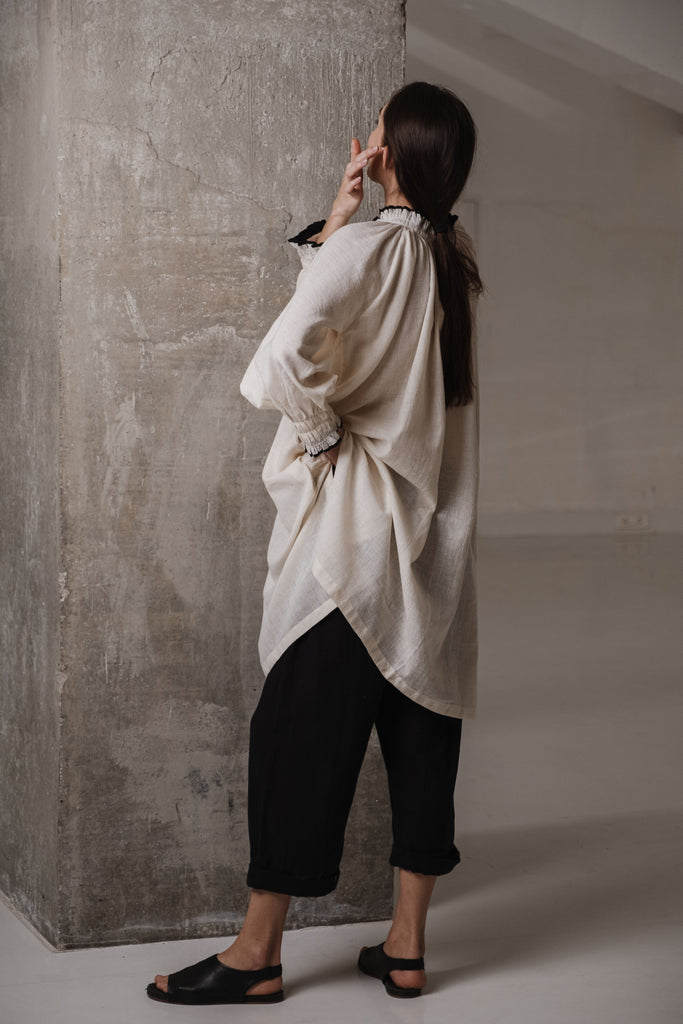 Small scale clothing companies in India. Off white tunic with gathers and smocking details. Organic clothing boutiques in India. best organic and sustainable clothing brands. american made organic clothing.
