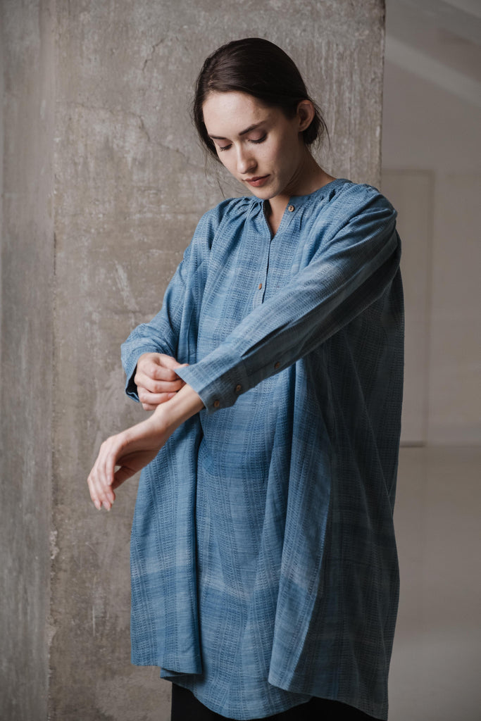 Comfort-fitted co-ord set of indigo oversized tunic and black pants made from handwoven organic cotton fabric handcrafted by the weavers of Kachchh. Organic cotton clothing available for bulk orders.