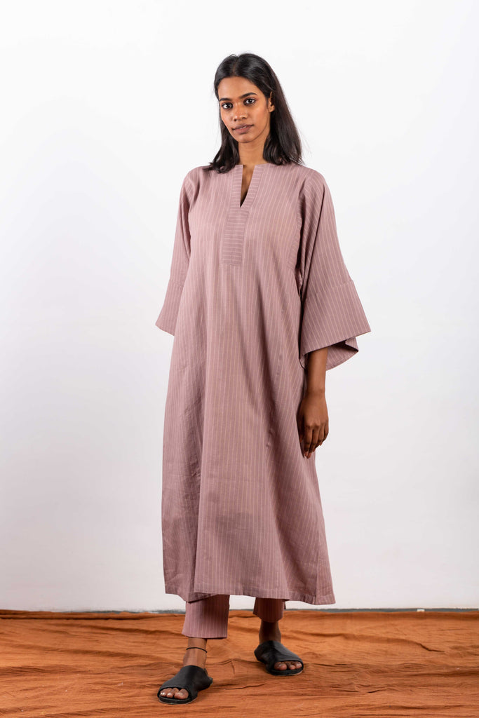 Eco luxury fashion from India, made with handwoven cotton and natural dye.