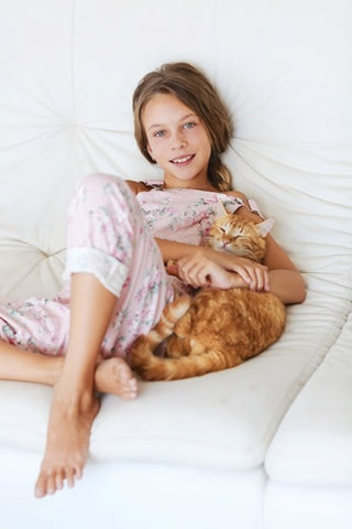 a girl with a pet cat