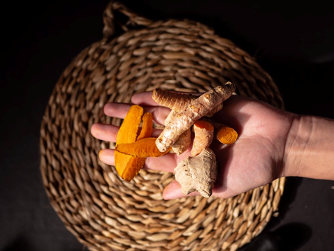 a person holding turmeric
