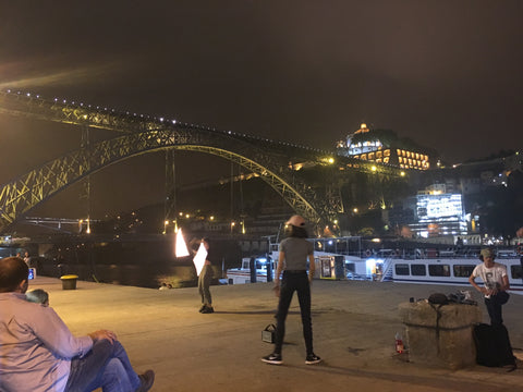 fire dancers under the eiffel bridge in porto