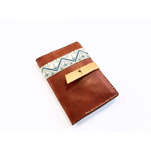 Front view of The Austin, handmade leather passport wallet.
